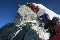 In this image released by mountain guide Adrian Ballinger of Alpenglow Expeditions and taken Saturday, May 18, 2013, climbers navigate the Hillary Step just below the summit of Mount Everest, in the Khumbu region of the Nepal Himalayas. Sixty years ago Wednesday, Sir Edmund Hillary and climbing partner Tenzing Norgay were the first to set foot on the summit of Mount Everest, the highest point on earth on May 29, 1953. (AP Photo/Alpenglow Expeditions, Adrian Ballinger) MANDATORY CREDIT, EDITORIAL USE ONLY